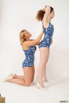 Nikki adjusts Chiara's posture