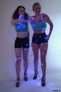 Chiara and Nikki in turquoise tops and black lycra girdle worn as hot pants