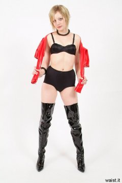 Carlie in red PVC jacket, black bra and girdle won as hot pants