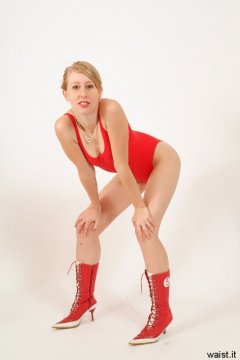 Dee in tight red one-piece swimsuit - Photo from Dee's retro swimwear and corsetry shoot, choreographed by Chiara 2005-09-30.