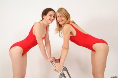 Chiara and Dee red one-piece swimsuits