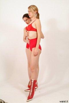 Chiara making Dee tuck in her tummy - Photo from Dee's retro swimwear and corsetry shoot, choreographed by Chiara 2005-09-30.