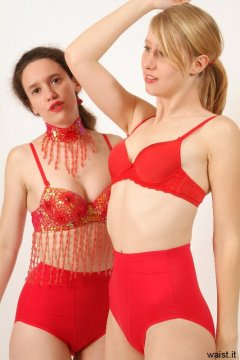 Chiara and Dee in red bras and girdles - Photo from Dee's retro swimwear and corsetry shoot, choreographed by Chiara 2005-09-30.