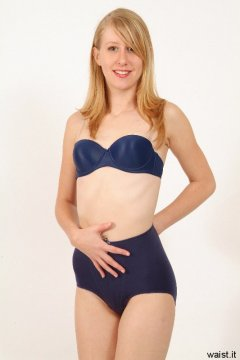 Dee in blue bra and girdle - Photo from Dee's retro swimwear and corsetry shoot, choreographed by Chiara 2005-09-30.