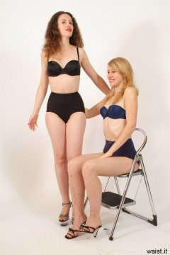 Chiara and Dee in black/blue bras and girdles - Photo from Dee's retro swimwear and corsetry shoot, choreographed by Chiara 2005-09-30.