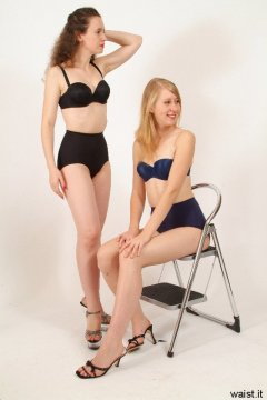 Chiara and Dee in black/blue bras and girdles