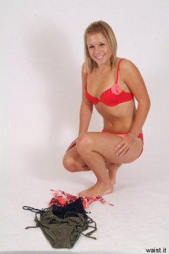 Sara in red bikini chooses outfits for shoot
