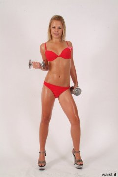 Oiled-up Sara in red bikini with weights