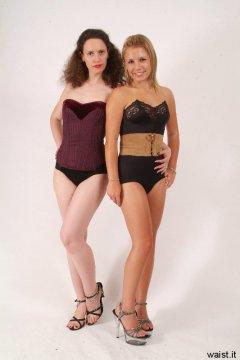 Chiara and Sara posing in corset outfits