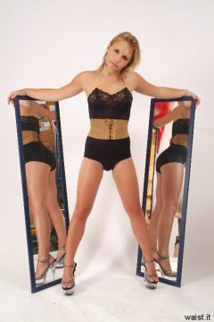 Sara with mirrors in black strapless bra, girdle and suede corset-belt
