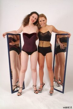 Corseted Chiara and Sara pose using mirrors