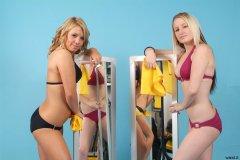 Sara and Jade clean the mirrors.