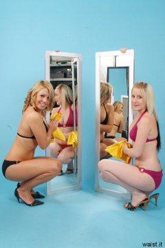 Sara and Jade clean the mirrors. Jade and Sara retro fitness shoot