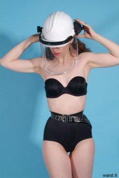 Chiara, hard hat, black bra, pantie girdle and very tight belt