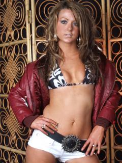 Shelley models bikini top, short-shorts and leather jacket