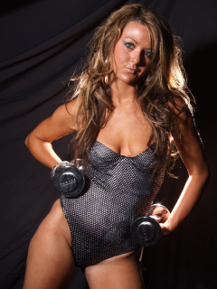 Shelley models silver one-piece swimsuit holding chrome weights