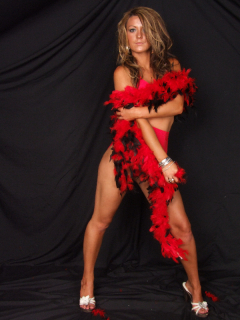 Shelley models red Chinese bra and pocket girdle, with feather boa