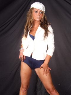 Shelley blue bra and girdle and her own white hat and jacket
