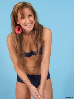 Jade gets the giggles, in matching royal blue padded bra and retro pantie gird