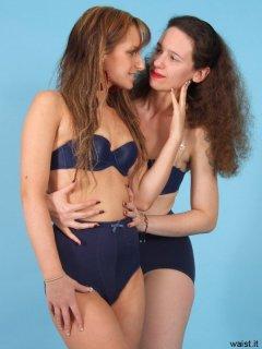 Jade and Chiara pose in matching royal blue padded bras and retro pantie girdles