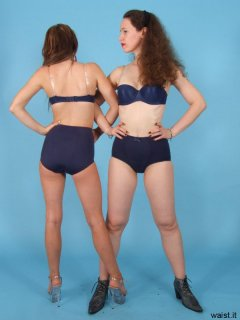 Jade and Chiara model matching blue bras and pantie girdles from both front and rear view