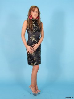 Jade models cheongsam again - this time with figure-smoothing bra and girdle worn underneath to give her a better shape