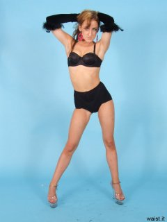 Jade poses in black bra and firm-control pantie girdle