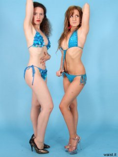 Chiara and Jade proudly display their concave waists