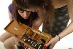 Cara Mascara and Chiara examine Roberts radio