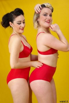 Tanya and Fiona work on their posture whilst modelling red bras and girdles