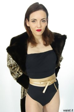 Anise in black vintage-style one-piece swimsuit and fur coat