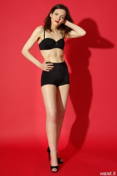 Anise in black bra worn as a top and and vintage pantie girdle worn as hotpants