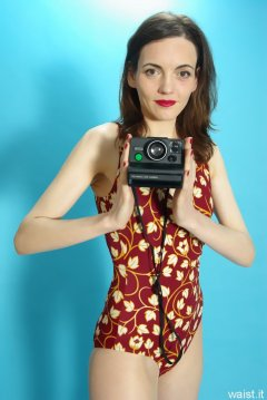 Anise in vintage-style tummy-control one-piece swimsuit,with Polaroid camera