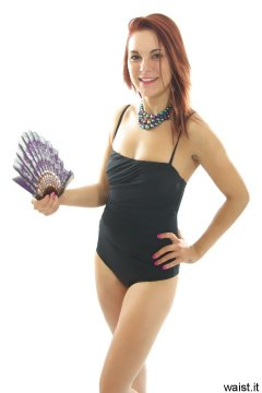 JT McQueen in black retro-styled tummy-control one-piece swimsuit