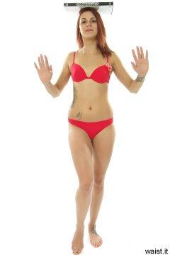 JT McQueen in red bikini doing deportment exercises