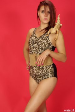 JT McQueen in animal print one-piece vintage-style swimsuit