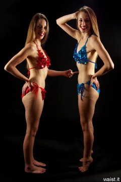 2 Josies in bikini-style dance costumes - tummy poke