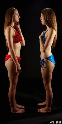 2 Josies in bikini-style dance costumes