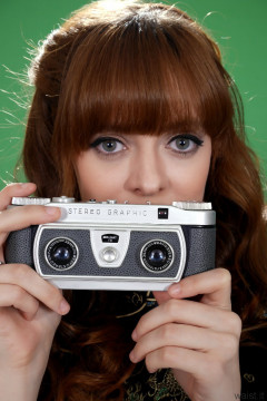Kirsten-Ria headshot c/w Wray Stereographic camera