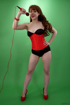 Kirsten-Ria red corset and black CHinese pantie girdle worn as hotpants