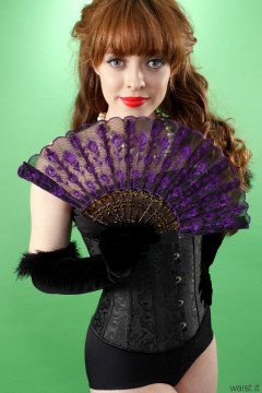 Kirsten-Ria black corset and girdle holding fan