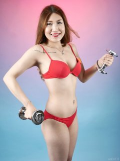 "2015-08-03 Laura Toy exercising in red ""love"" bikini"
