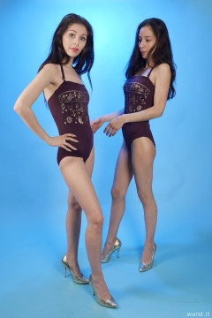2015-11-21 Heydi and Shannon in maroon and gold one-piece swimsuits