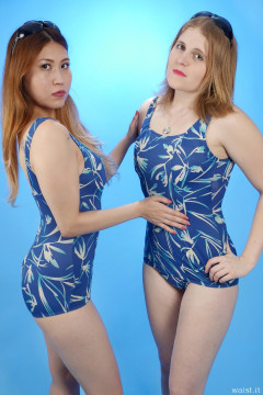 2015-12-11 Laura Toy pats Chelskii's belly to remind her to tuck in - wearing blue BHS one-piece tummy-control swimsuits
