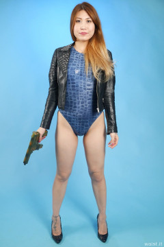 2015-12-11 Laura Toy looking tough in leather jacket and figure-hugging crocskin swimsuit