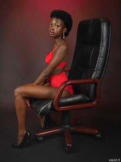 2016-01-15 Lilli in red bra and girdle on black leather chair