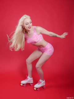 2016-04-23 Dayna Nirvana roller skating in pink two piece costume