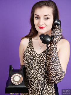 2016-12-04 Nannina in animal print swimsuit, using vintage Bakelite telephone