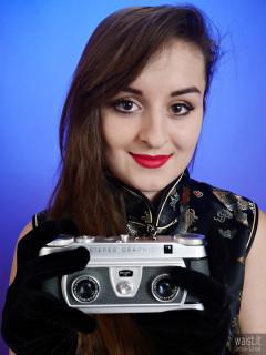 2016-12-04 Nannina in full-length cheongsam holding Wray Stereographic camera