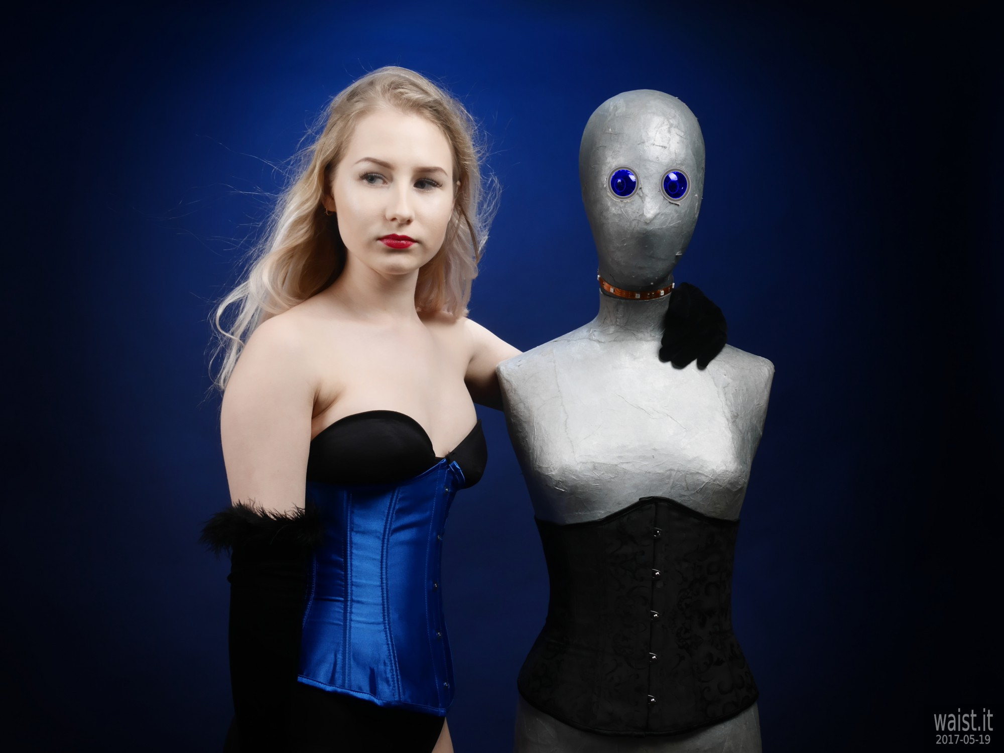 2017-05-19 Laura Sele tightly laced blue underbust corset worn over black Miraclesuit bodyshaper